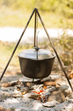Typical Hungarian Gulys (Soup) is jut cooking in Cauldron