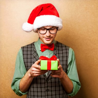 hipster in Santa Claus clothes