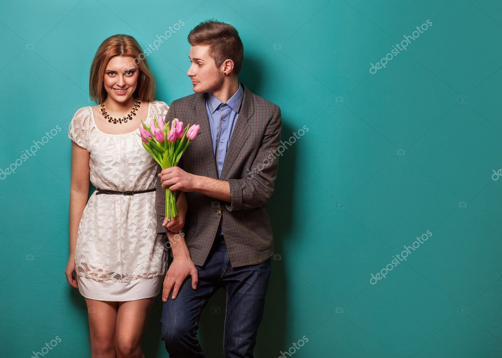 beautiful couple in love with flowers tulips