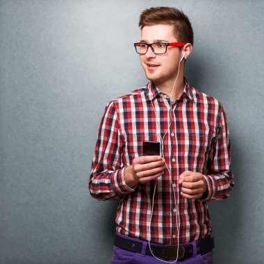 Young man listening to music. Hipster style
