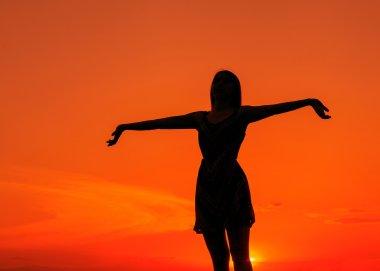 Girl silhouette in the field