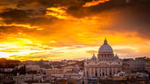 Fotografie Basilica of St. Peter at sunset with the Vatican in the backgrou