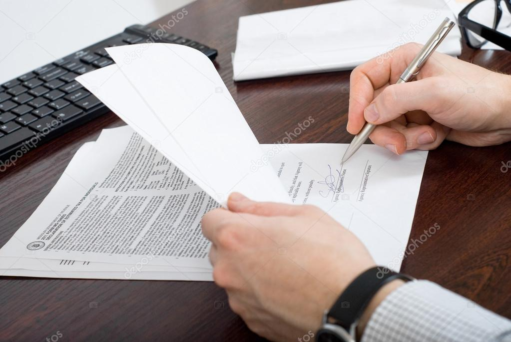 Business man signing  the  tax form