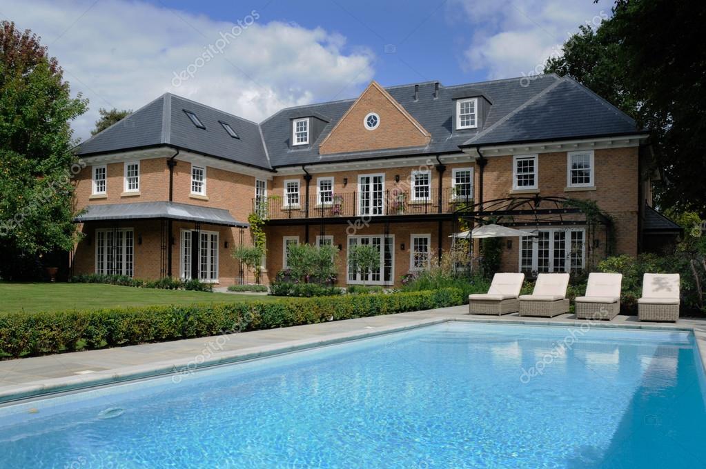 https://st.depositphotos.com/1016551/3396/i/950/depositphotos_33963147-stock-photo-house-with-pool.jpg