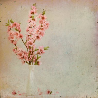Vintage floral background with pink flowers on a brown backgroun