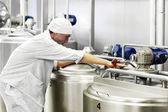 Fotografie worker on a milk factory