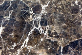 hnědý přírodní mramor. krásné mnohobarevná interiérové dekorativní kámen mramor abstraktní praskliny a skvrny na povrchu.