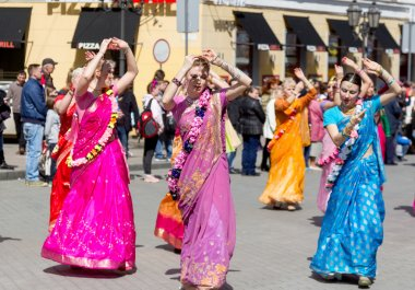 ODESSA, UKRAINE - APRIL 1: Devotees from Hare Krishna dancing wi