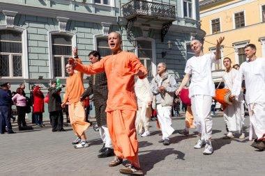 ODESSA, UKRAINE - APRIL 1: Devotees from Hare Krishna dancing wi