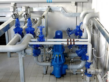 Water pumping station, industrial interior and pipes. Water syst