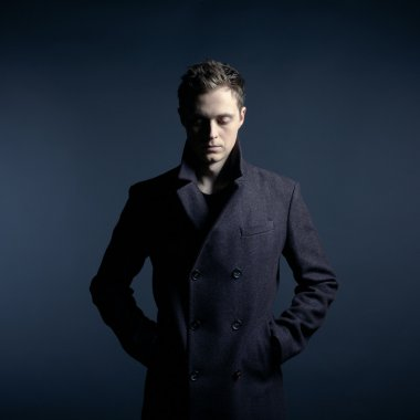 Portrait of handsome stylish man in coat