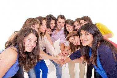 Teamwork: Group of diverse joining hands