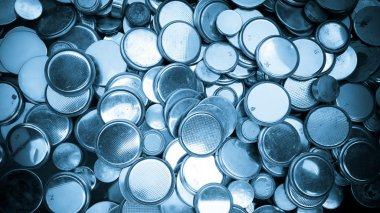 Lithium batteries of various sizes background blue toned