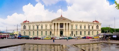 San Salvador, El Salvador - 03-04-2014 Front view of the Presidential Palace with traffic jam