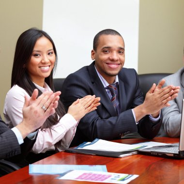 Multi ethnic business group greets you