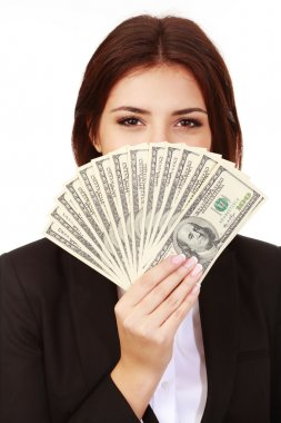 Businesswoman covering her face with dollars
