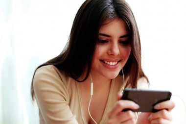 Smiling student using smartphone