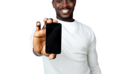 African man showing blank smartphone display