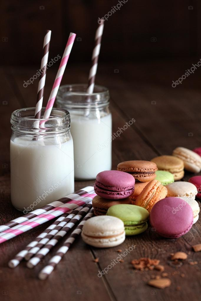 Colorful macaroons with jar glasses and straws