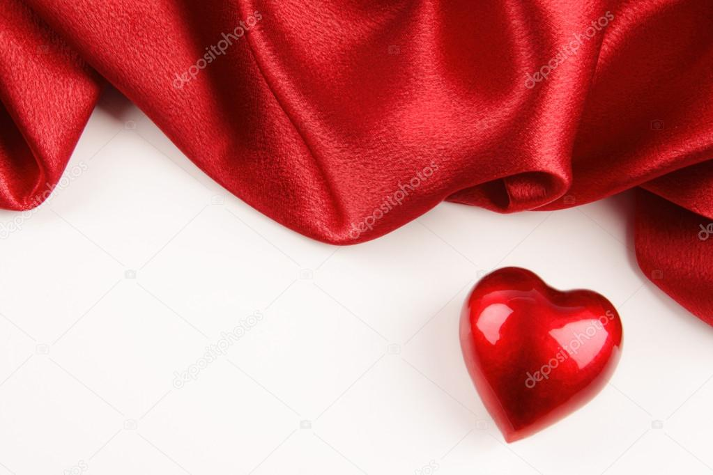 Valentine heart with red silk on off white background