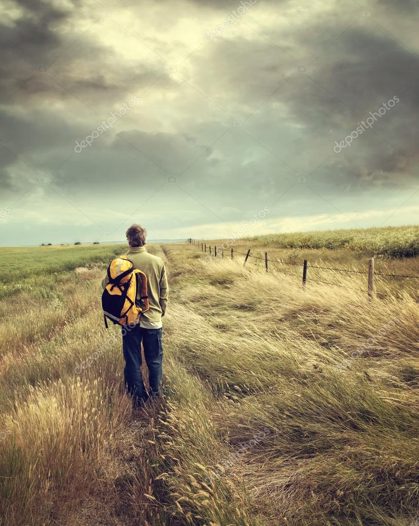 Man walking down country road
