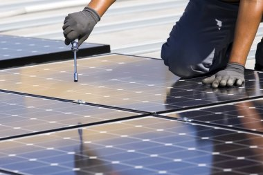Workers set photovoltaic panels