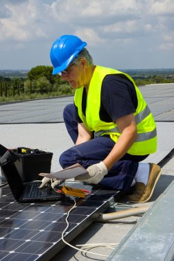Engineer testing solar panels