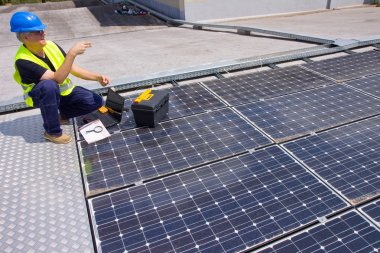Engineer testing solar panels