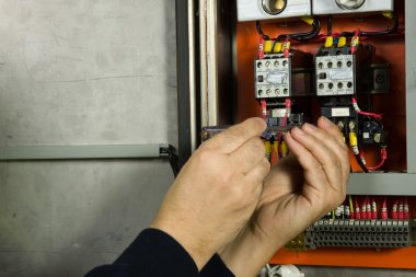 Senior electrician check the electrical panel