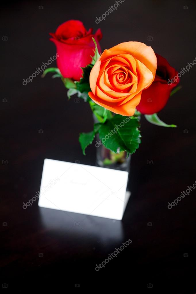 bouquet of colorful roses in a vase and card with the words than