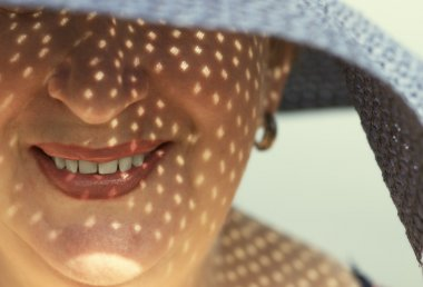 happy woman with broad-brim