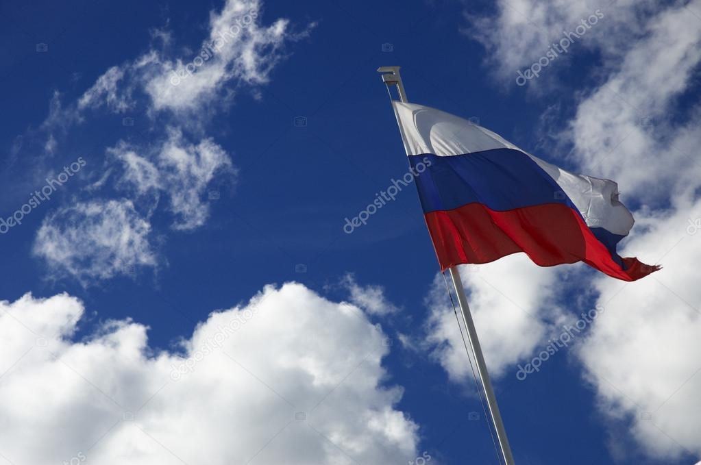 Flag of the Russia on the sky background