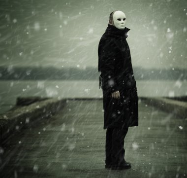 man with white mask near the river