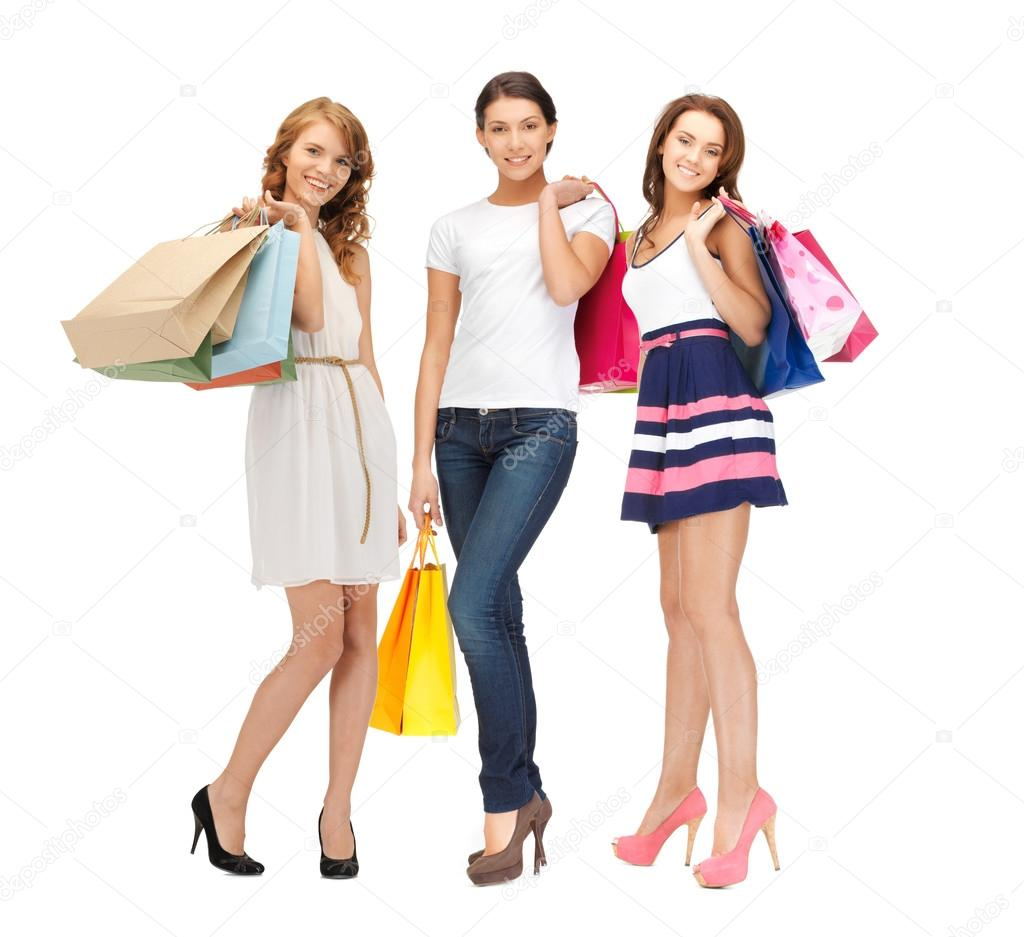 Attractive girls holding color shopping bags — Stock Photo ...