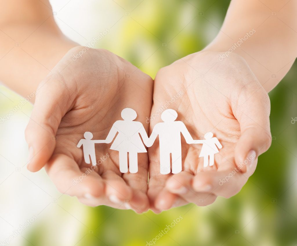Womans hands with paper man family ⬇ Stock Photo, Image by ©  Syda_Productions #31565591