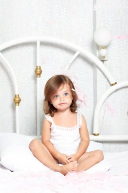 Puzzled little girl