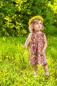 Fotografie Löwenzahn lockiges Mädchen