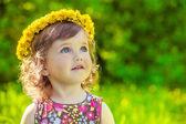 Fotografie Mädchen mit gelben Headwreath auf
