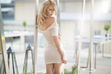 Sexy blonde woman in white dress