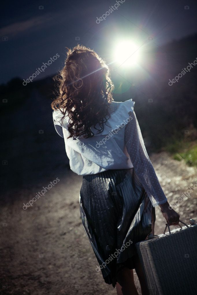 Brunette walking at the night