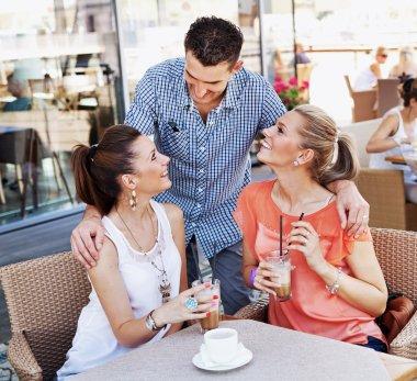 Young friends having coffee break