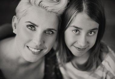 Blonde mother enjoying daughter