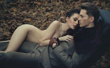 Naked woman hugging young man