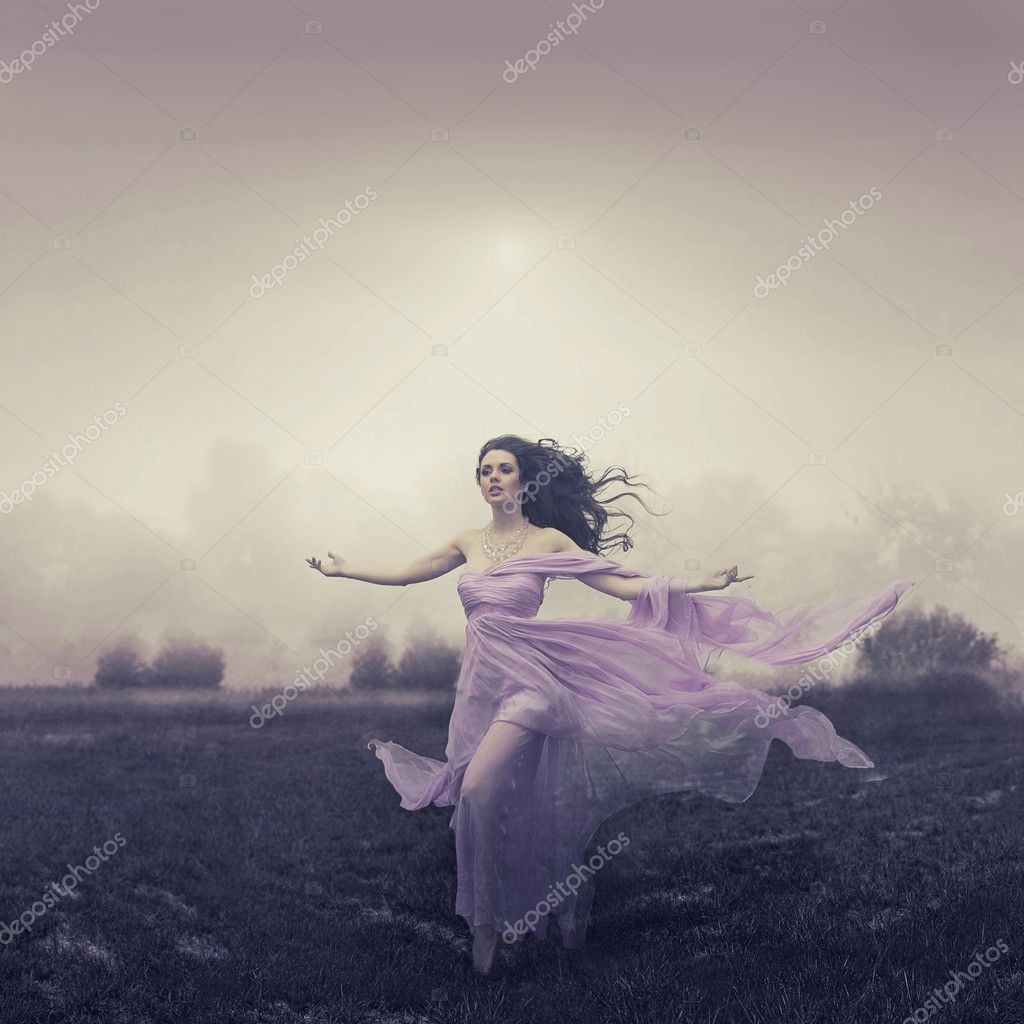 Portrait of woman running over the field