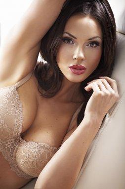 Clean skin lady wearing sensual bra