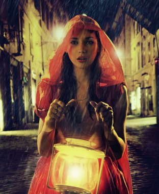Innocent woman in red holding the lantern