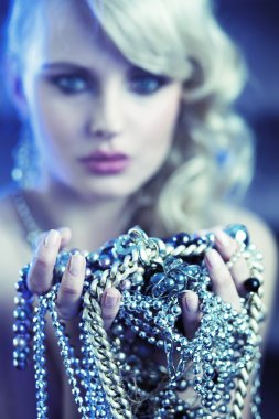 Amazing blonde woman with jewelary