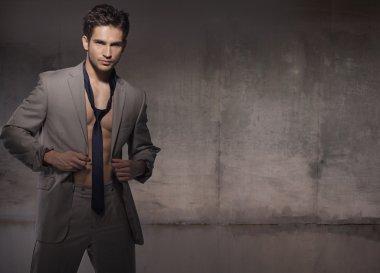 Muscular model wearing trendy suit