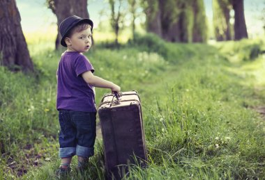 Little man leaving home with huge luggage