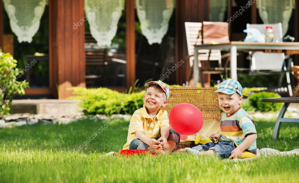 Two cute kids playing in the garden